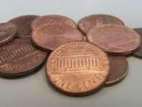 pile-of-pennies-every-little-bit-counts-when-saving-1000-a-month